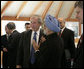 President George W. Bush talks briefly with Prime Minister Manmohan Singh of India, Friday, June 8, 2007, after a G8 working session with Outreach Representatives at the Kempinski Grand Hotel in Heiligendamm, Germany. White House photo by Eric Draper