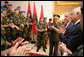 Albanian troops applaud President George W. Bush Sunday, June 10, 2007, after he greeted them at the Palace of Brigades in Tirana. The greeting came during the daylong visit that marked the first time a sitting U.S. president has been in the country. White House photo by Eric Draper