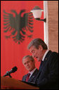 President George W. Bush listens to an interpretation of the remarks by Albania's Prime Minister Sali Berisha during a joint press availability Sunday, June 10, 2007, in Tirana, Albania. The visit marked the first to the country by a sitting president and came on the second to the last day of a seven-day, European tour. White House photo by Chris Greenberg
