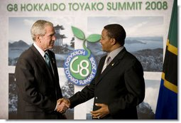 President George W. Bush and President Jakaya Kikwete exchange handshakes Monday, July 7, 2008, after meeting the media in Toyako, Japan, following the G-8 Working Session with the Africa Outreach Representatives. White House photo by Eric Draper