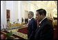 President George W. Bush and President Susilo Bambang Yudhoyono of Indonesia, walk to the podium for a joint press availability Monday, Nov. 20, 2006, at the Bogor Palace in Bogor, Indonesia. The Presidents reaffirmed the strength and vitality of their bilateral relationship, and recognized the special and enduring bonds between the two countries and their people. White House photo by Eric Draper