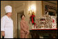 Mrs. Laura Bush and former chef Roland Mesnier discusses the gingerbread White House with the press in the State Dining Room Thursday, Nov. 30, 2006. The house consists of more than 300 pounds of dark chocolate and gingerbread. White House photo by Shealah Craighead