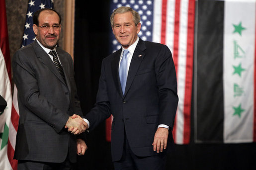 """President George W. Bush and Prime Minister Nouri al-Maliki shake hands after a joint press availability Thursday, Nov. 30, 2006, in Amman, Jordan. The leaders later issued a joint statement in which they said they were, """"Pleased to continue our consultations on building security and stability in Iraq."""" White House photo by Paul Morse"""