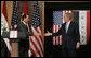 President George W. Bush reaches out to Iraqi Prime Minister Nouri al-Maliki Thursday, Nov. 30, 2006, following a joint press availability in Amman, Jordan. White House photo by Paul Morse