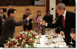 """President George W. Bush exchanges toasts with Viet President Nguyen Minh Triet during a State Banquet Friday, Nov. 17, 2006, at the International Convention Center in Hanoi. President Bush told his host, """"Vietnam is a country that's taking its rightful place as a strong and vibrant nation,"""" adding he hoped its people know they have the friendship of the American people.  White House photo by Paul Morse"""