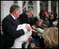 """President George W. Bush invites children to meet """"Flyer"""" the turkey, held by Lynn Nutt of Springfield, Mo., during a ceremony Wednesday, Nov. 22, 2006 in the White House Rose Garden, following the President's pardoning of the turkey before the Thanksgiving holiday. White House photo by Paul Morse"""