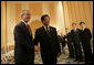 """President George W. Bush is greeted by President Hu Jintao of China at the Hanoi Daewoo Hotel in Hanoi after his arrival Sunday, Nov. 19, 2006, for bilateral talks. President Bush told President Hu, """"China is a very important nation, and the United States believes strongly that by working together, we can help solve problems."""" White House photo by Eric Draper"""