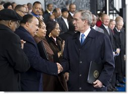 President George W. Bush greets Martin Luther King III and his sisters, Yolanda Denise King and Bernice Albertine King, Monday, Nov. 13, 2006, following President Bush's speech at the groundbreaking ceremony for the Martin Luther King Jr. National Memorial on the National Mall in Washington, D.C. White House photo by Eric Draper
