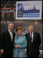 President George W. Bush stands with President Vaira Vike-Freiberga of Latvia, and NATO Secretary General Jaap de Hoop Scheffer during a photo opportunity Wednesday, Nov. 29, 2006, at the start of the 2006 NATO Summit in Riga, Latvia. White House photo by Paul Morse