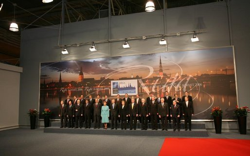 NATO heads of state and government stand for the official portrait Wednesday, Nov. 29, 2006, at the 2006 NATO Summit in Riga, Latvia. White House photo by Paul Morse