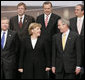President George W. Bush and Chancellor Angela Merkel of Germany join other NATO heads of state and government for the official portrait Wednesday, Nov. 29, 2006, at the 2006 NATO Summit in Riga, Latvia. White House photo by Paul Morse