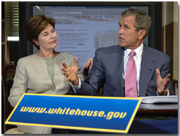 Guided by White House Webmaster Jane Cook (not pictured), President Bush and Laura Bush tour through the new, restructured White House website in the historic Dwight D. Eisenhower Executive Office Building Library Aug. 31. The new site is more accessible for the disabled community, photo essays, a Spanish section and a kids' page. White House photo by Eric Draper.