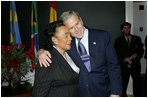 President George W. Bush hugs Coretta Scott King after laying a wreath laying at the grave of Dr. Martin Luther King, Jr. in Atlanta, Georgia, Thursday, Jan. 15, 2004.