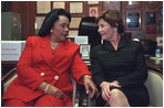 Laura Bush speaks with Coretta Scott King during a Jan. 21, 2002 visit to the Ebenezer Baptist Church in Atlanta, Ga.