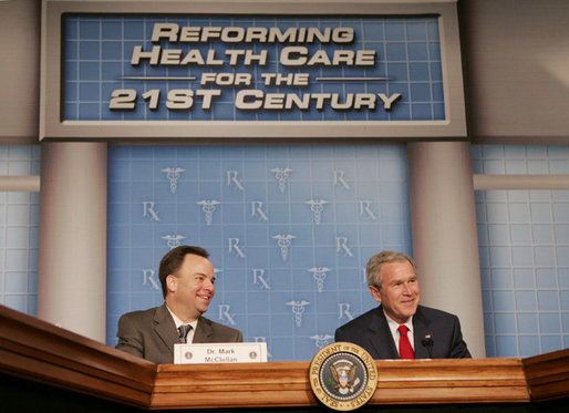 President George W. Bush joins Dr. Mark McClellan, administrator of the Centers for Medicare and Medicaid Services, at a panel discussion Thursday, Feb. 16, 2006 on health care initiatives at the U.S. Department of Health and Human Services in Washington. White House photo by Kimberlee Hewitt