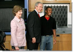 President George W. Bush and Mrs. Laura Bush greet student Michael Harrell during a visit with science and engineering students at the Yvonne A. Ewell Townview Magnet Center in Dallas, Texas, Friday, Feb. 3, 2006.  White House photo by Eric Draper