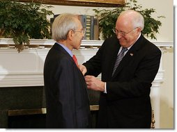Vice President Dick Cheney presents the Distinguished Service Cross to Lieutenant Bernard W. Bail in the Roosevelt Room at the White House, Friday, February 24, 2006. The Distinguished Service Cross is awarded to a person who while serving in any capacity with the U.S. Army distinguished himself or herself by extraordinary heroism. After Lt. Bail's aircraft took heavy anti-aircraft fire that killed the pilot and wounded other crew members over the English Channel on June 5, 1944, Lt. Bail displayed such acts of valor and ultimately prevented the aircraft, loaded with a full ordnance, from crashing into an English village.  White House photo by David Bohrer