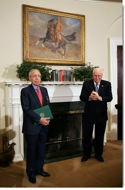 """Vice President Dick Cheney applauds Lieutenant Bernard W. Bail, recipient of the Distinguished Service Cross, in the Roosevelt Room at the White House, Friday, February 24, 2006. The Vice President awarded the Distinguished Service Cross to Lt. Bail for his extraordinary acts of heroism during World War II and commended Lt. Bail for being a """"brave citizen who elevated service to country above self interest.""""  White House photo by David Bohrer"""