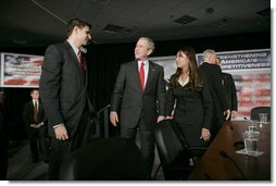 President George W. Bush speaks with participants Justin Sanchez, left, and Nicole Lopez after a panel on American competitiveness Friday, Feb. 3, 2006, at Intel Corporation in Rio Rancho, N.M.  White House photo by Eric Draper