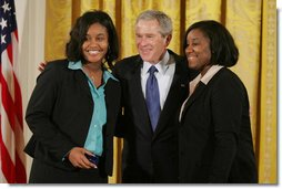 """President George W. Bush congratulates Carrietha """"Katie"""" Ball and her sister, Karl'Nequa Ball of Jackson, Miss., after awarding them the President's Volunteer Service Awards during a White House celebration of African American History Month. White House photo by Paul Morse"""