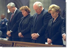 Bowing their heads in prayer, NASA Administrator Sean O'Keefe, far left, Laura O'Keefe, left, Vice President Dick Cheney, center, and Lynne Cheney attend a memorial service for the Space Shuttle Columbia astronauts at the National Cathedral in Washington, D.C., Thursday, Feb. 6, 2003. The seven astronauts died when the space shuttle broke apart upon re-entering the atmosphere Feb. 1, 2003.  White House photo by David Bohrer