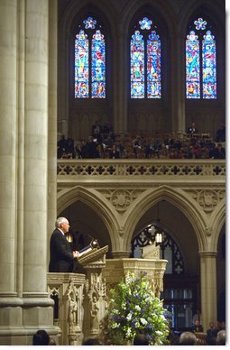 "Vice President Dick Cheney speaks during a memorial service at the National Cathedral in Washington, D.C., Thursday, Feb. 6, 2003 for the seven astronauts who died in the Feb. 1 Space Shuttle Columbia tragedy. ""The crew of the Columbia was united not by faith or heritage, but by the calling they answered and shared,"" the Vice President said. ""They were bound together in the great cause of discovery. They were envoys to the unknown. They advanced human understanding by showing human courage.""   White House photo by David Bohrer"