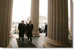 John Snow, the newly appointed Secretary of Treasury, walks with President George W. Bush to his swearing-in ceremony at The Treasury Building Friday, Feb. 7, 2003.   White House photo by Paul Morse