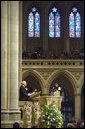 """Vice President Dick Cheney speaks during a memorial service at the National Cathedral in Washington, D.C., Thursday, Feb. 6, 2003 for the seven astronauts who died in the Feb. 1 Space Shuttle Columbia tragedy. """"The crew of the Columbia was united not by faith or heritage, but by the calling they answered and shared,"""" the Vice President said. """"They were bound together in the great cause of discovery. They were envoys to the unknown. They advanced human understanding by showing human courage."""" White House photo by David Bohrer"""