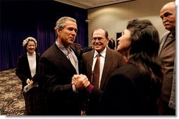 After meeting privately with the leadership and graduates of Campus for Human Development, President George W. Bush talks with program graduates David Barclay, left, LuAnn Nicholas, center, and Bob Head at Opryland in Nashville, Tenn., Feb. 10, 2003.  White House photo by Tina Hager