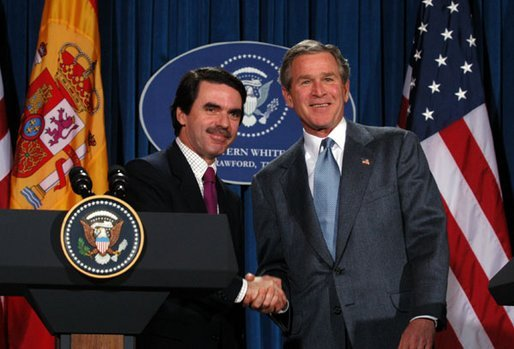President George W. Bush and President Jose Maria Aznar of Spain shake hands at the end a joint press conference at the Bush Ranch in Crawford, Texas, Saturday, Feb. 22, 2003. White House photo by Eric Draper.