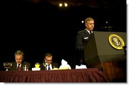 """Led in prayer by the Chairman of the Joint Chiefs of Staff General Richard Myers, President George W. Bush and Congressman Ray LaHood (R-IL) pray during the National Prayer Breakfast in Washington, D.C., Thursday, Feb. 6, 2003. """"In this hour of our country's history, we stand in the need of prayer. We pray for the families that have known recent loss. We pray for the men and women who serve around the world to defend our freedom,"""" said the President in his remarks. """"We pray for their families. We pray for wisdom to know and do what is right. And we pray for God's peace in the affairs of men.""""  White House photo by Eric Draper"""
