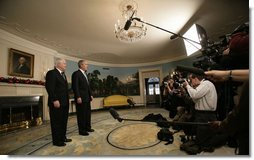 """President George W. Bush and Robert Gates, the President's nominee for Secretary of Defense, stand before the press Tuesday morning, Dec. 5, 2006, in the Diplomatic Reception Room of the White House. Said the President, """"Bob Gates will be a fine Secretary of Defense. I hope for a speedy confirmation so he can get sworn in and get to work."""" White House photo by Eric Draper"""