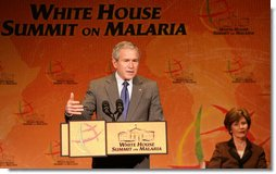 President George W. Bush, joined by Laura Bush, addresses participants at the first-ever White House Summit on Malaria, Thursday, Dec, 14, 2006, at the National Geographic Society in Washington, D.C. President Bush's Malaria Initiative is a five-year $1.2 billion program to eradicate malaria in 15 countries.  White House photo by Shealah Craighead