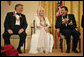 """Conductor Zubin Mehta laughs with singers Dolly Parton and William """"Smokey"""" Robinson during a reception for the Kennedy Center honorees in the East Room Sunday, Dec. 3, 2006. White House photo by Eric Draper"""