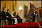 """President George W. Bush speaks during a reception for the Kennedy Center honorees in the East Room Sunday, Dec. 3, 2006. They are, from left: musical theater composer Andrew Lloyd Webber; conductor Zubin Mehta; country singer Dolly Parton; singer and songwriter William """"Smokey"""" Robinson; and film director Steven Spielberg. White House photo by Shealah Craighead"""