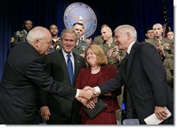 Vice President Dick Cheney and President George W. Bush congratulate Robert Gates and his wife Becky after his swearing-in ceremony as Secretary of Defense at the Pentagon Monday, Dec. 18, 2006.  White House photo by Eric Draper