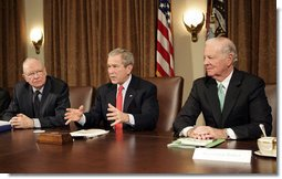"""President George W. Bush addresses the press during a meeting with the Iraq Study Group in the Cabinet Room Wednesday, Dec. 6. 2006. Pictured with the President are the group's co-chairmen former Representative Lee Hamilton, left, and former Secretary of State James Baker. The group presented a report assessing the situation in Iraq. In his comments to the press, the President said, """". this report will give us all an opportunity to find common ground, for the good of the country -- not for the good of the Republican Party or the Democratic Party, but for the good of the country.""""  White House photo by Eric Draper"""