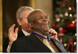 "B.B. King breaks out in laughter as he's presented with the Presidential Medal of Freedom Friday, Dec. 15, 2006, by President George W. Bush in the East Room of the White House. Introducing the musician, President Bush told the audience, when speaking of the blues, ""two names are paramount. B.B. King, and his guitar, Lucille. America loves the music of B.B. King, and America loves the man, himself.""  White House photo by Shealah Craighead"