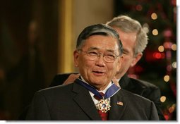 "President George W. Bush presents the 2006 Presidential Medal of Freedom to former Secretary of Transportation Norman Mineta during ceremonies Friday, Dec. 15, 2006, in the East Room of the White House. Upon introduction, President Bush said, ""Norman Mineta's whole life has been an extraordinary journey. he has given his country a lifetime of leadership, devotion to duty and personal character.""  White House photo by Shealah Craighead"