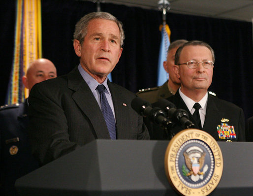 President George W. Bush answers questions from reporters following his meeting on Iraq with U.S. military leaders at the Pentagon, Wednesday, Dec. 13, 2006. Admiral Edmund P. Giambastiani is seen at right. White House photo by Eric Draper