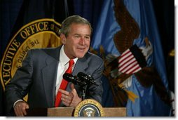 """President George W. Bush talks with the employees of National Capital Flag Company in Alexandria. Va., about his Growth and Jobs Package, Thursday, Jan. 9, 2003. """"This is a plan to encourage growth, focusing on jobs. And the Council of Economic Advisors has predicted that these proposals will create 2.1 million new jobs over the next three years. That's good for the American people. It's good for our economy, """" President Bush said after his tour of the company.  White House photo by Paul Morse"""