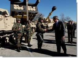 President George W. Bush greets army soldiers in front of tank equipment during a visit to Fort Hood in Killeen, Texas, Friday, Jan. 3, 2003.  White House photo by Eric Draper