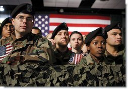 """Army troops and personnel listen to President George W. Bush during his visit to Fort Hood in Killeen, Texas, Friday, Jan. 3, 2003. """"Ft. Hood and the units that call it home have a special place in our country's military history, said the President. """"For decades, soldiers from the First Team and the Iron Horse Division, and from other units, have fought America's battles with distinction and courage.""""  White House photo by Eric Draper"""