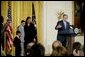 """President George W. Bush addresses the audience during a program honoring graduates of welfare-to-work programs in the East Room Tuesday, Jan. 14, 2003. """"In the seven years since welfare was reformed, millions of Americans have shared in this experience. Their lives and our country are better off. Today, more than 2 million fewer families are on welfare -- 2 million fewer than in 1996. It's a reduction of 54 percent,"""" said the President. White House photo by Paul Morse."""