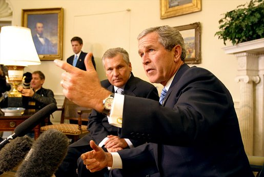 President George W. Bush and Polish President Aleksander Kwasniewski meet with the media in the Oval Office Jan. 14, 2003. White House photo by Paul Morse.