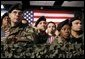 """Army troops and personnel listen to President George W. Bush during his visit to Fort Hood in Killeen, Texas, Friday, Jan. 3, 2003. """"Ft. Hood and the units that call it home have a special place in our country's military history, said the President. """"For decades, soldiers from the First Team and the Iron Horse Division, and from other units, have fought America's battles with distinction and courage."""" White House photo by Eric Draper."""
