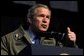 """President George W. Bush speaks to troops during his visit to Fort Hood in Killeen, Texas, Friday, Jan. 3, 2003. """"Our country is in a great contest of will and purpose. We're being tested. In times of crisis, we will act decisively,"""" said the President in his remarks. """"And in times of calm, we'll be focused and patient and relentless in our pursuit of the enemy. That's what we owe the American people."""" White House photo by Eric Draper."""