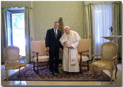 After attending the G-8 Summit in Genoa, President Bush traveled to Rome to meet His Holiness Pope John Paul II July 23, 2001. In addition to posing for photos, the two leaders took a short walk together and talked privately. White House photo by Eric Draper.