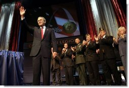 """President George W. Bush addresses the 85th Annual American Legion Convention in St. Louis, Mo., Tuesday, Aug. 26, 2003. """"In the 20th century, the American flag and the American uniform stood for something unique in history,"""" President Bush said in his remarks. """"America's armed forces humbled tyrants and raised up and befriended nations that once fought against us.""""  White House photo by Paul Morse"""