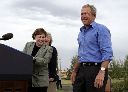 President George W. Bush is introduced by Secretary of Agriculture Ann Veneman before discussing his healthy forest initiative in Redmond, Ore., Thursday, August 21, 2003. Secretary of the interior Gale Norton is pictured in the background. White House photo by Paul Morse.